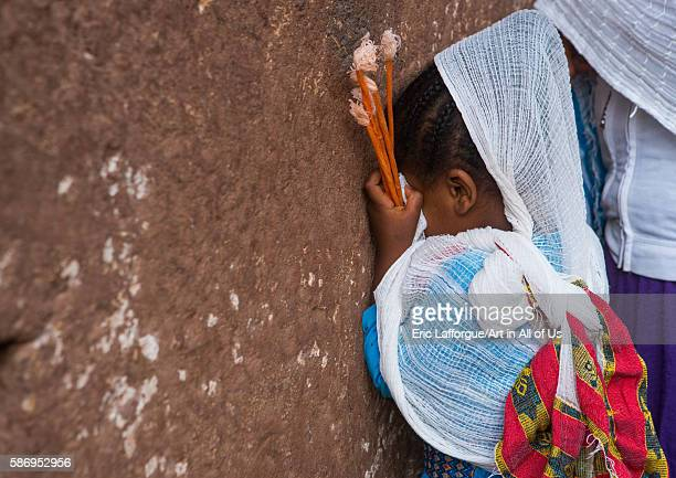 Pilgrim girl praying during kidane mehret orthodox celebration amhara region lalibela Ethiopia on February 24 2016 in Lalibela Ethiopia