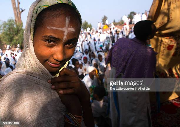 Pilgrim girl with a cross sign on the forehead during kidane mehret orthodox celebration amhara region lalibela Ethiopia on February 24 2016 in...