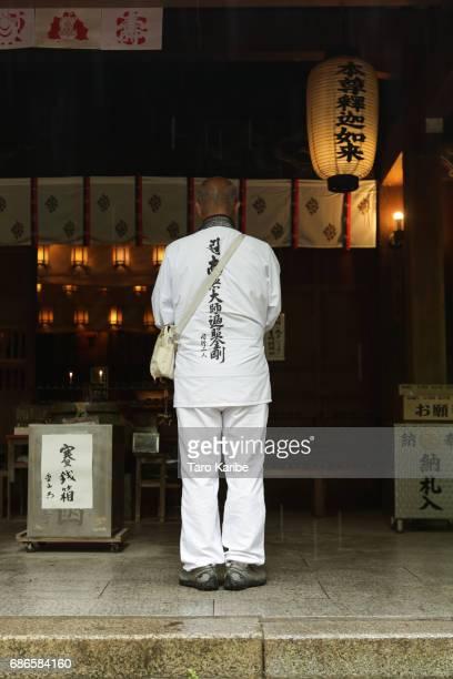 A pilgrim gives worship at temple No1 'Ryozanji' on April 26 2017 in Naruto Japan The Shikoku Henro or Shikoku Pilgrimage is a 1200 kmlong sacred...