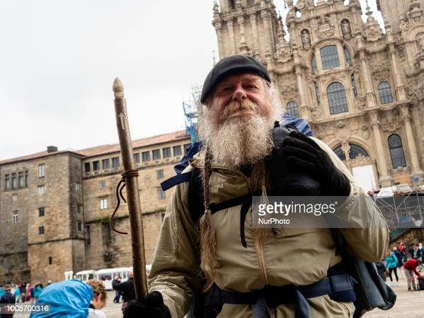 Pilgrim just arrived at Santiago Walking around the 'Plaza del Obradoiro' where the Santiago de Compostela Church it is situated you can see during...