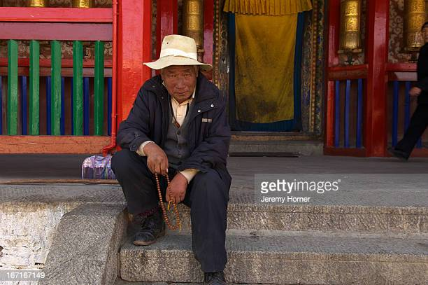 Pilgrim Labrang Monastery during Tibetan New Year celebrations Gansu Province China Labrang Monastery is one of six monasteries of the Geluk school...