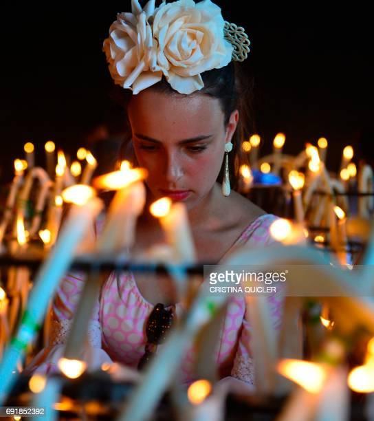 A pilgrim lights candles in the village of El Rocio during the annual El Rocio pilgrimage on June 3 2017 in Villamanrique near Sevilla El Rocio...