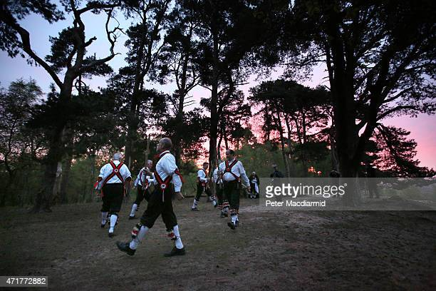 Pilgrim Morris Men dance on St Martha's Hill at dawn in celebration of May Day on May 1 2015 in Chilworth England Founded in 1972 the Pilgrim Morris...