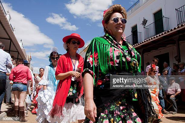 Pilgrim of the Brotherhood of El Rocío de la Palma County, procession accompanying his Brotherhood, dressed in different costumes, to make the...
