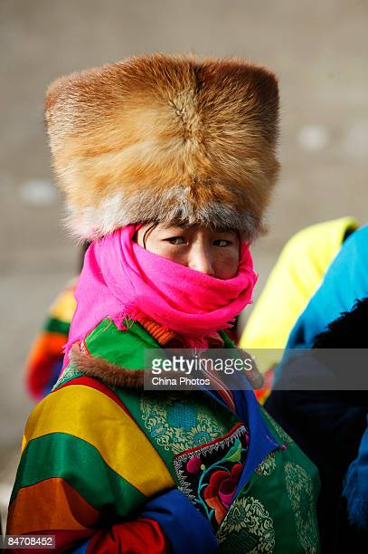 A pilgrim of Tu ethnic minority group attends the 'Tiaoqian' praying ceremony at the Youning Temple on February 8 2009 in Huzhu County of Qinghai...