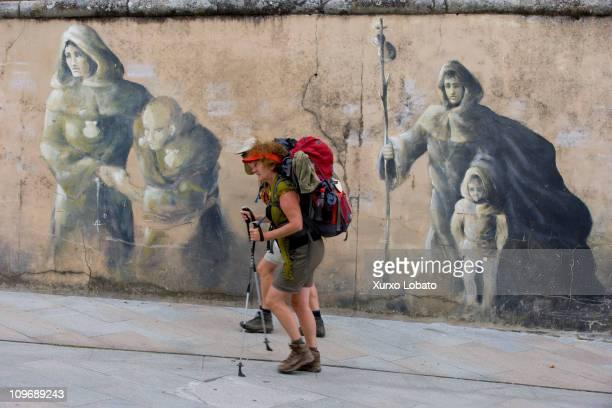 Pilgrim on the Camino de Santiago walking in the village of Sarria Galicia 1th June 2010