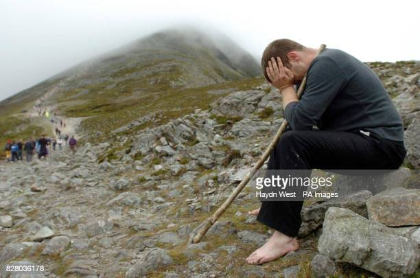 Pilgrim Owen Maughan takes a break during the annual climb to the summit of Croagh Patrick in Co Mayo Around 20000 people are expected to complete...