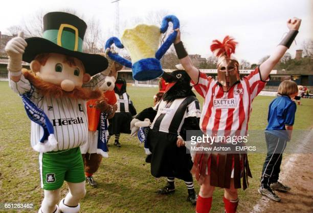 Pilgrim Pete of Plymouth Argyle and Alex the Greek of Exeter City celebrate winning the Battle of the Mascots match at Gay Meadow home of Shrewsbury...