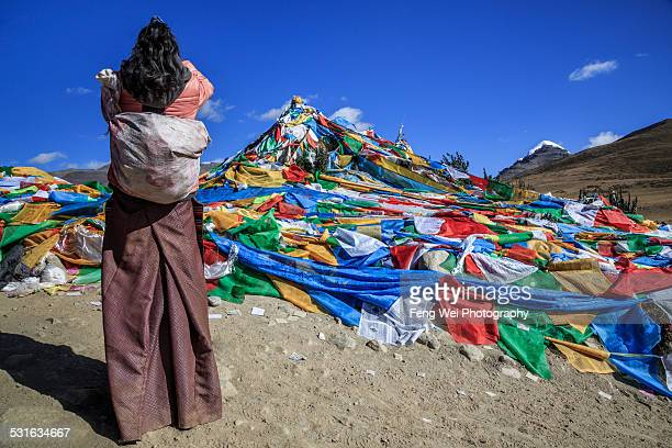 pilgrim praying before holy mountain kailash - ceremony stock pictures, royalty-free photos & images