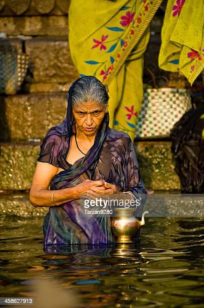 Pilgrim praying on the bank of Ganges River