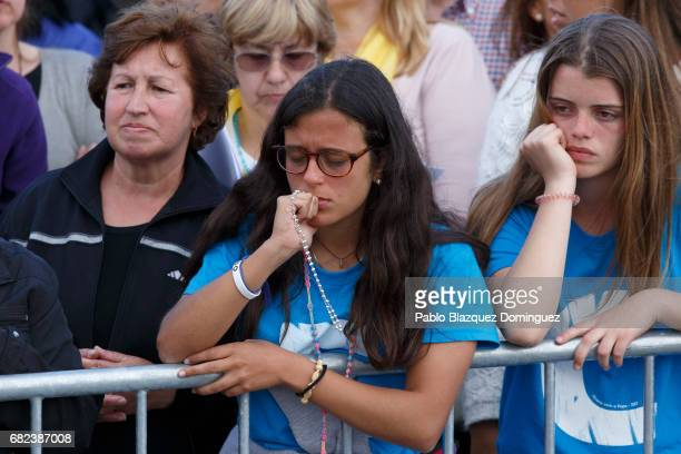 A pilgrim prays as Pope Francis stays at the Sanctuary of Fatima on May 12 2017 in Fatima Portugal Pope Francis will be attending the Sanctuary of...