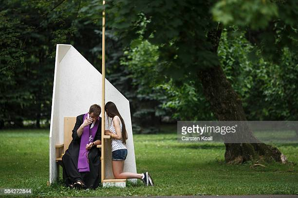 A pilgrim receives the sacrament of confession in Jordan Park on July 28 2016 in Krakow Poland Almost two million young people are expected to attend...