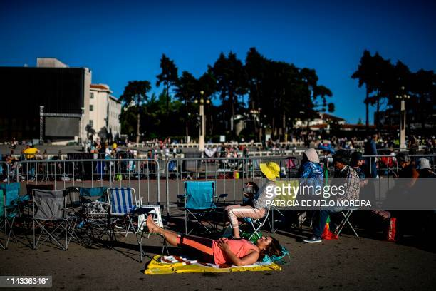 A pilgrim rests at the Fatima shrine in Fatima central Portugal on May 12 2019 Thousands of pilgrims converged on the Fatima Sanctuary to celebrate...
