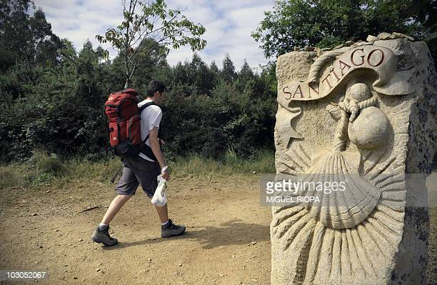 SANTAFE A pilgrim walks the Way of Saint James some 15 km from Santiago de Compostela northwestern Spain on July 21 2010 Thousands of pilgrims arrive...