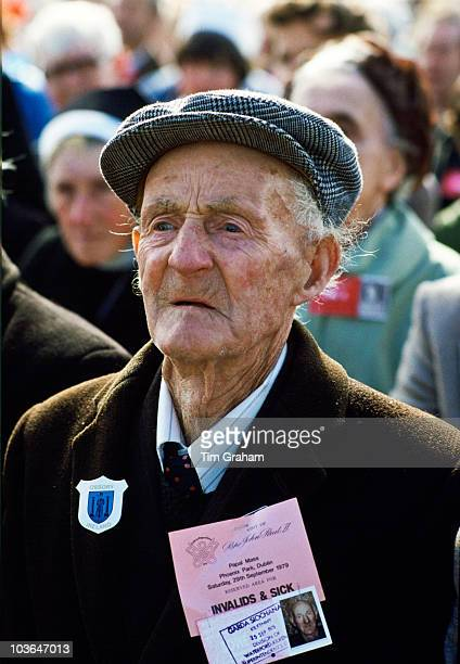 A pilgrim with an official identity pass attends mass celebrated by Pope John Paul II during his visit to Ireland on September 29 in Knock Ireland