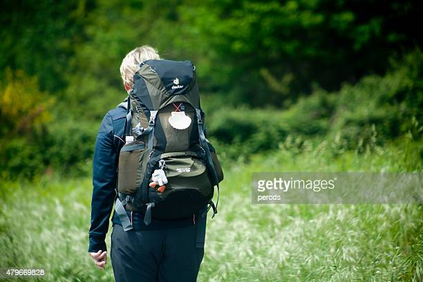 "Pilgrim with rucksack and scallop in the ""camino de Santiago"""