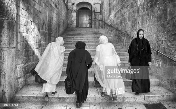4 pilgrim women, going up the stairs in via delarosa,the holy city. - antonia fortress stock pictures, royalty-free photos & images