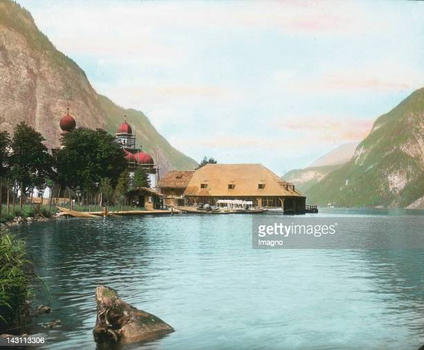 Pilgrimage church St Bartholomae and a hunting lodge with tavern on the peninsula Hirschau in Koenigssee Bavaria Germany Handcolored lantern slide...