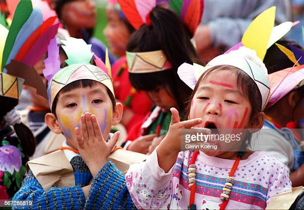 Pilgrims 11/22/95#45958–left to rightJames Nguyen age 5 and Minah No ##CQ%% age 6 dressed as Indians hoot and holler##playing Indian%% during the...