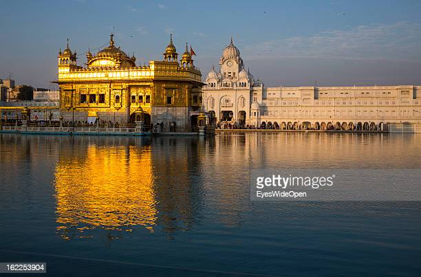 Pilgrims and tourists visit the Golden Temple a central religious place of the Sikhs on November 25 2012 in Amritsar Punjab India