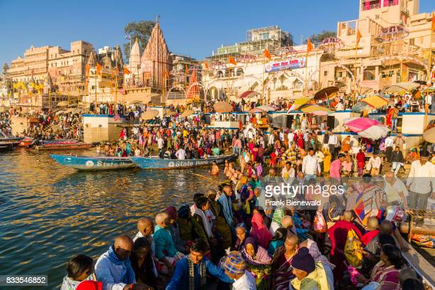 Pilgrims are taking a boat ride on the holy river Ganges at Dashashwamedh Ghat, Main Ghat, in the suburb Godowlia.