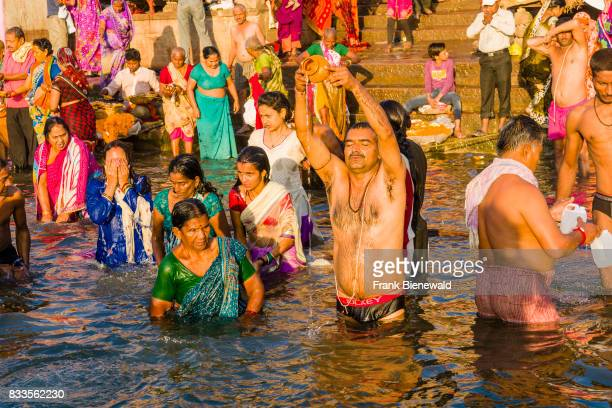 Pilgrims are taking bath in the holy river Ganges at Dashashwamedh Ghat Main Ghat in the suburb Godowlia