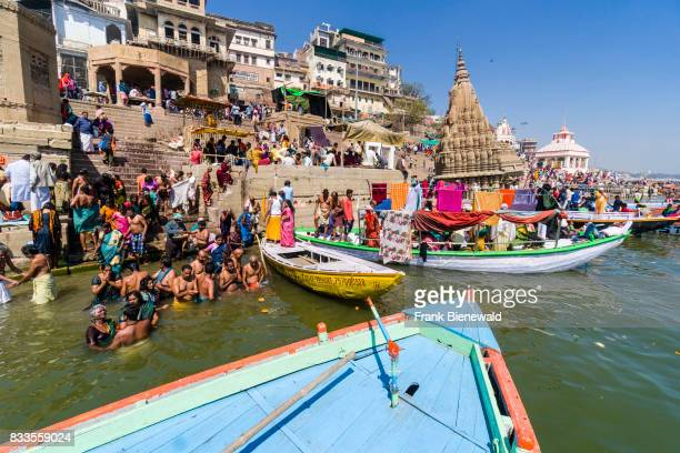 Pilgrims are taking bath in the holy river Ganges at Manikarnika Ghat in the suburb Godowlia.