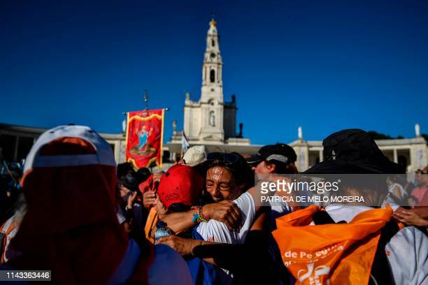 Pilgrims arrive at the Fatima shrine in Fatima, central Portugal, on May 12, 2019. - Thousands of pilgrims converged on the Fatima Sanctuary to...