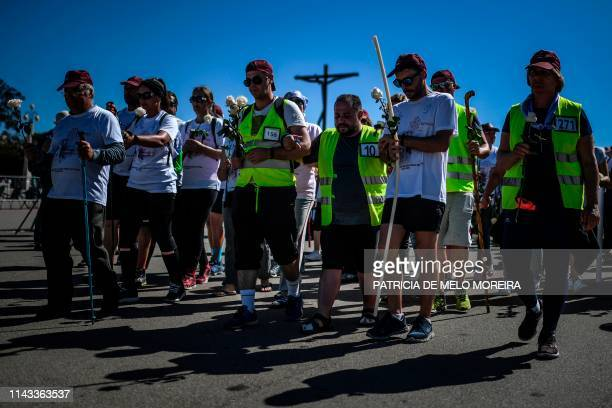 TOPSHOT Pilgrims arrive at the Fatima shrine in Fatima central Portugal on May 12 2019 Thousands of pilgrims converged on the Fatima Sanctuary to...