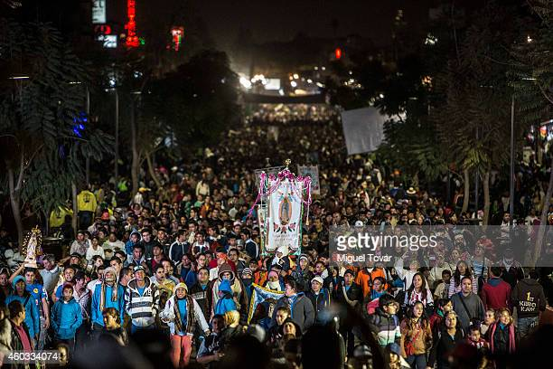 Pilgrims arrive to the Basilica of Guadalupe on December 11 2014 in Mexico City Mexico The Mexican tradition narrates the apparitions of the Virgin...