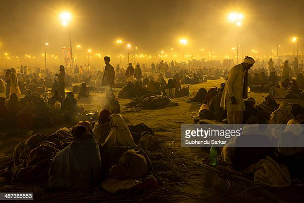 Pilgrims assemble at night on the grounds of Maha Kumbh mela, ready to take holy dip in the morning. Kumbh Mela is a site of mass pilgrimage in which...