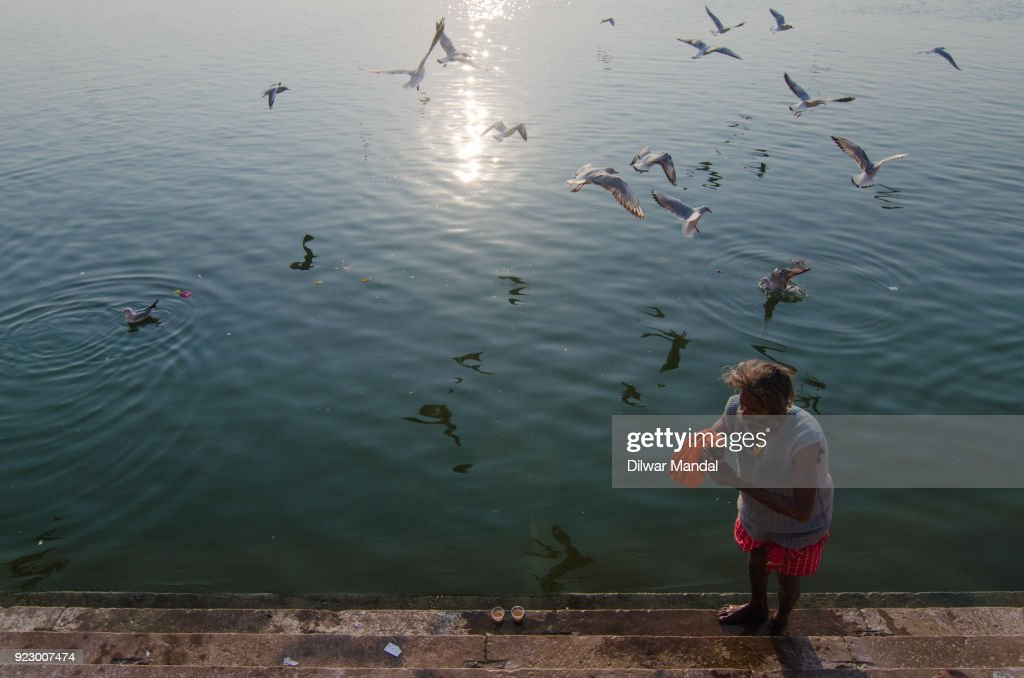 A pilgrims at banks of river Ganges : Stock Photo