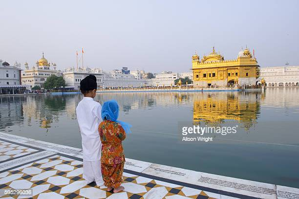 pilgrims at the golden temple - amritsar stock photos and pictures