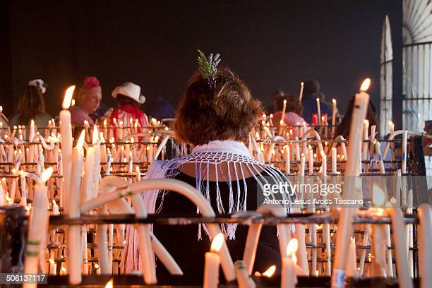 Pilgrims at the Shrine, offering candles to the Virgin of El Rocío as a promise. Pilgrimage of El Rocio, Traditions and Festivities, Religion and...