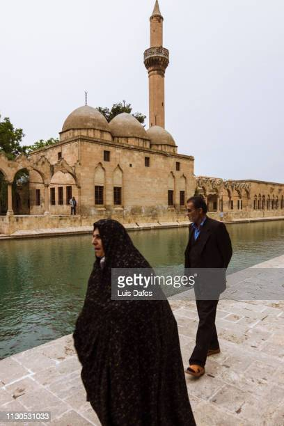 pilgrims at urfa´s golbasi - dafos stock photos and pictures