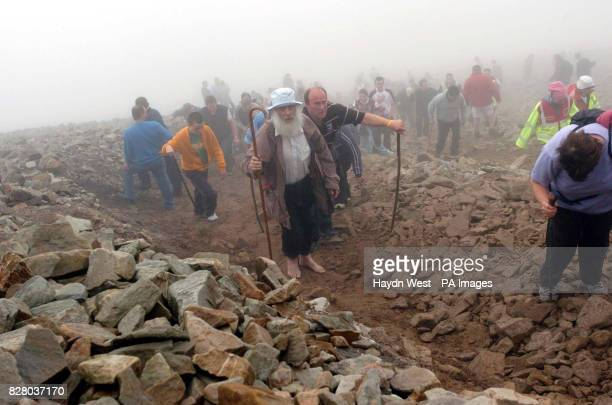 Pilgrims attempt the annual climb to the summit of Croagh Patrick in Co Mayo Around 20000 people are expected to complete this year's pilgrimage...