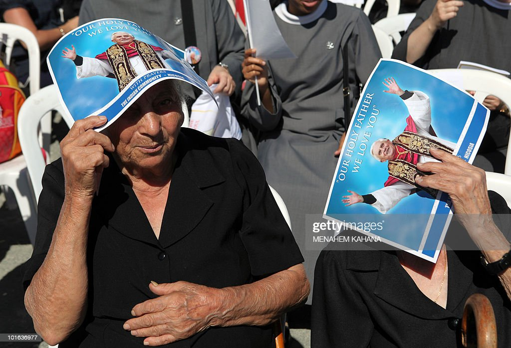 Pilgrims attend a ceremony with Pope Benedict XVI at a Maronite elementary school in Nicosia on June 5, 2010 on the second day of the pontiff's visit to the mainly Greek Orthodox Mediterranean island.