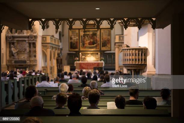 Pilgrims attend a service in the Town and Parish Church of St Mary's were reformer Martin Luther preached on May 27 2017 in Wittenberg Germany Up to...