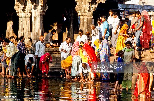 Pilgrims bath in the source of the holy river Godavari to wash away sinns