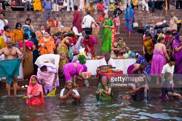 Pilgrims bathe at dawn in the river Ganges.
