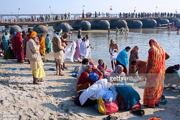 Pilgrims bathe at Maha Kumbh mela. Kumbh Mela is a site of mass pilgrimage in which Hindus gather at a sacred river for a holy dip. It is held once...