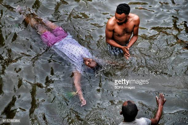 Pilgrims bathing in the blessed waters of the Fasilides Baths The annual Timkat festival an Orthodox Christian celebration of Epiphany remembers the...