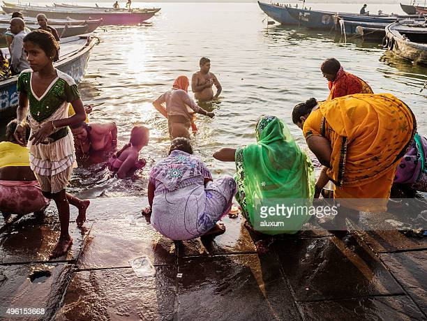 pilgrims bathing in the ganges in varanasi india - pilgrims and indians stock photos and pictures