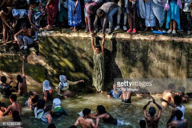 Pilgrims bathing in the waters of the Fasilides Baths The annual Timkat festival an Orthodox Christian celebration of Epiphany remembers the baptism...