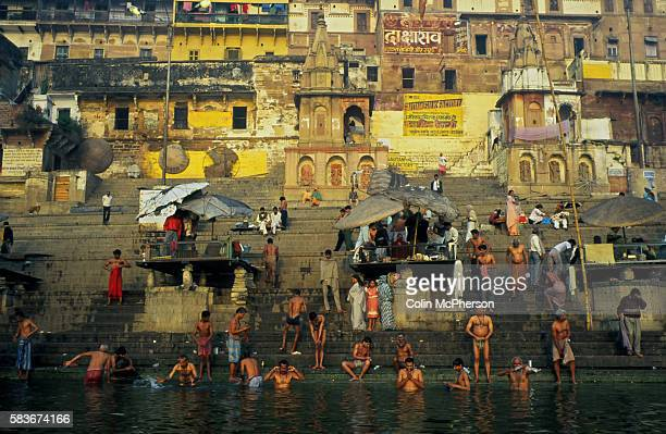 Pilgrims bathing in the waters of the river Ganges at Banares at dawn. Also commonly known as Varanasi and Kashi, it was a city situated on the banks...