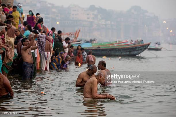 Pilgrims bathing on Varanasi Ghats for Diwali, The Festival of Lights, Varanasi, Uttar Pradesh, India