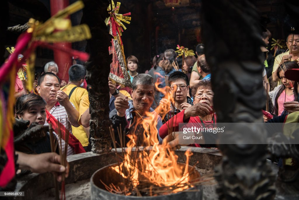 Pilgrims burn incense sticks in Xingang Fengtian Temple where the statue of Mazu will rest for two nights before resuming its journey, on day four of the nine day Mazu pilgrimage on April 16, 2018 in Xingang, Taiwan. The annual Mazu Pilgrimage begins at Jenn LannTemple in Taichung and sees around 200,000 pilgrims walk up to 12 hours each day for nine days carrying a statue of Chinese sea goddess Mazu in a sedan chair. The journey covers around 350 kilometres and visits more than 100 temples before returning to Taichung. The centuries-old pilgrimage is now recognised by UNESCO as living heritage and with an estimated 5 million participants spread over the nine days, it is considered to be one of the greatest religious festivals in the world.