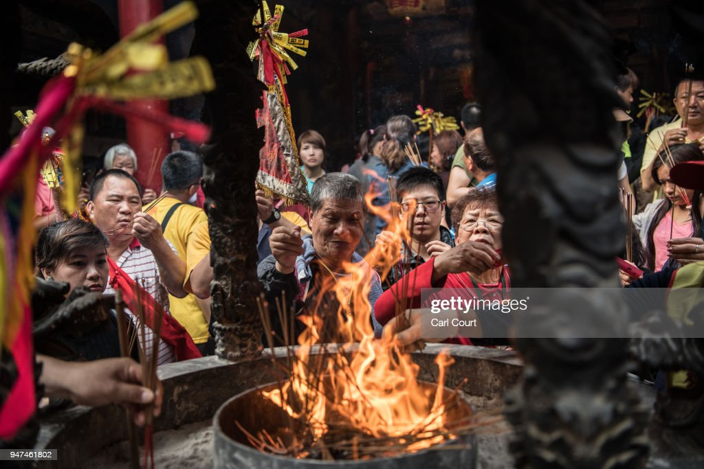 Pilgrims burn incense sticks in Xingang Fengtian Temple where the statue of Mazu will rest for two nights before resuming its journey, on day four of the nine day Mazu pilgrimage on April 16, 2018 in Xingang, Taiwan. The annual Mazu Pilgrimage begins at Jenn Lann Temple in Taichung and sees around 200,000 pilgrims walk up to 12 hours each day for nine days carrying a statue of Chinese sea goddess Mazu in a sedan chair. The journey covers around 350 kilometres and visits more than 100 temples before returning to Taichung. The centuries-old pilgrimage is now recognised by UNESCO as living heritage and with an estimated 5 million participants spread over the nine days, it is considered to be one of the greatest religious festivals in the world.