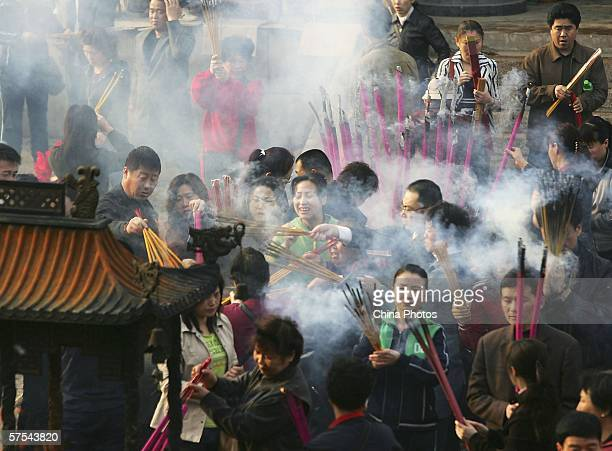 Pilgrims burn incenses and pray during a ceremony to mark the Buddha's birthday at Zhengjue Temple, one of China's largest Buddhist nunneries, on May...