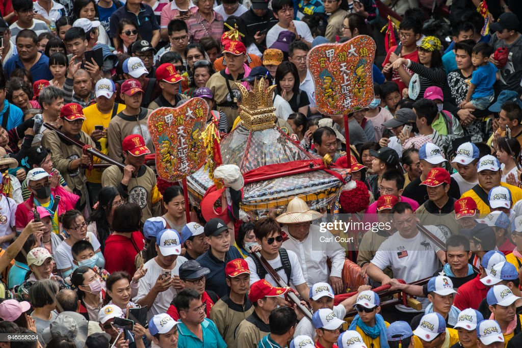 Pilgrims carry a sedan chair holding a statue of the goddess Mazu as they arrive at Houtian Temple on day three of the nine day Mazu pilgrimage on April 15, 2018 in Xizhou, Taiwan. The annual Mazu Pilgrimage begins at Jenn Lann Temple in Taichung and sees around 200,000 pilgrims walk up to 12 hours each day for nine days carrying a statue of Chinese sea goddess Mazu in a sedan chair. The journey covers around 350 kilometres, much of it through mountainous and rugged terrain and visits more than 100 temples before returning to Taichung. The centuries-old pilgrimage is now recognised by UNESCO as living heritage and with an estimated 5 million participants spread over the nine days, it is considered to be one of the greatest religious festivals in the world.